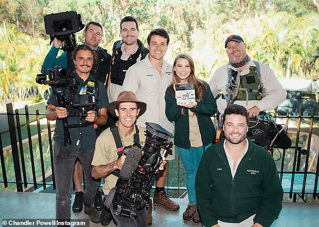 Back to work: Chandler Powell revealed that the new season of Crikey It's The Irwins! alongside a series of on-set photos featuring his wife Bindi Irwin and the crew