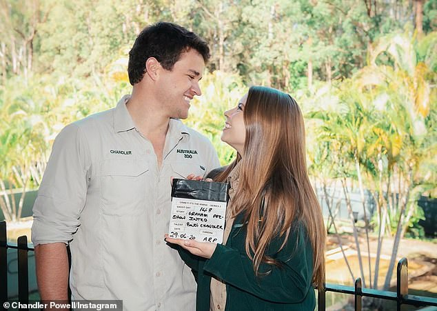 Loved-up: The couple dressed casually in their Australia Zoo uniforms and Bindi wore her long locks down