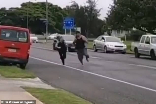 A female police officer is seen chasing after a man and trying to pepper spray him