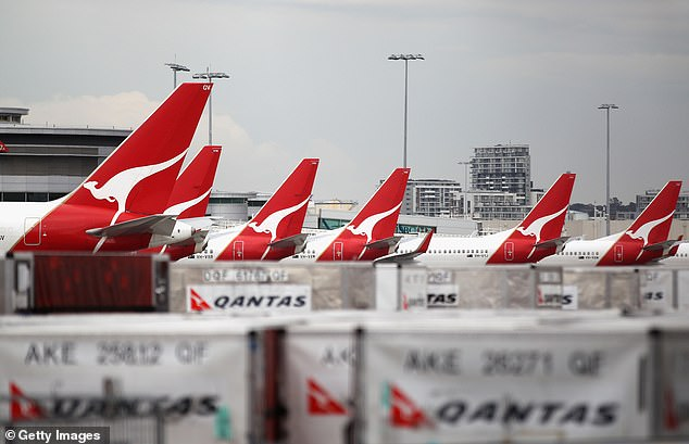 Qantas planes grounded at Sydney Airport. The airline recently sacked 6,000 workers while Flight Centre has let go of 16,000 staff globally