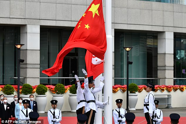 The Chinese and Hong Kong flags are unfurled during a flag-raising ceremony at the Golden Bauhinia Square in Hong Kong
