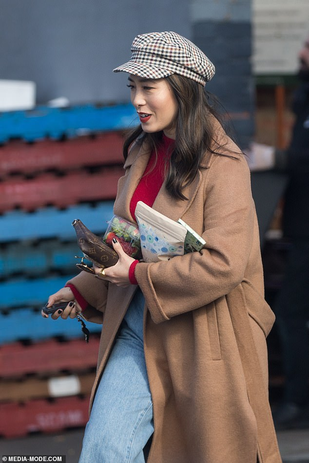 What you got there?Melissa quickly popped out of the studio with her hands full, carrying chocolate and strawberries.She held onto a Louis Vuitton coin purse in classic monogrammed leather, which is available for $1300