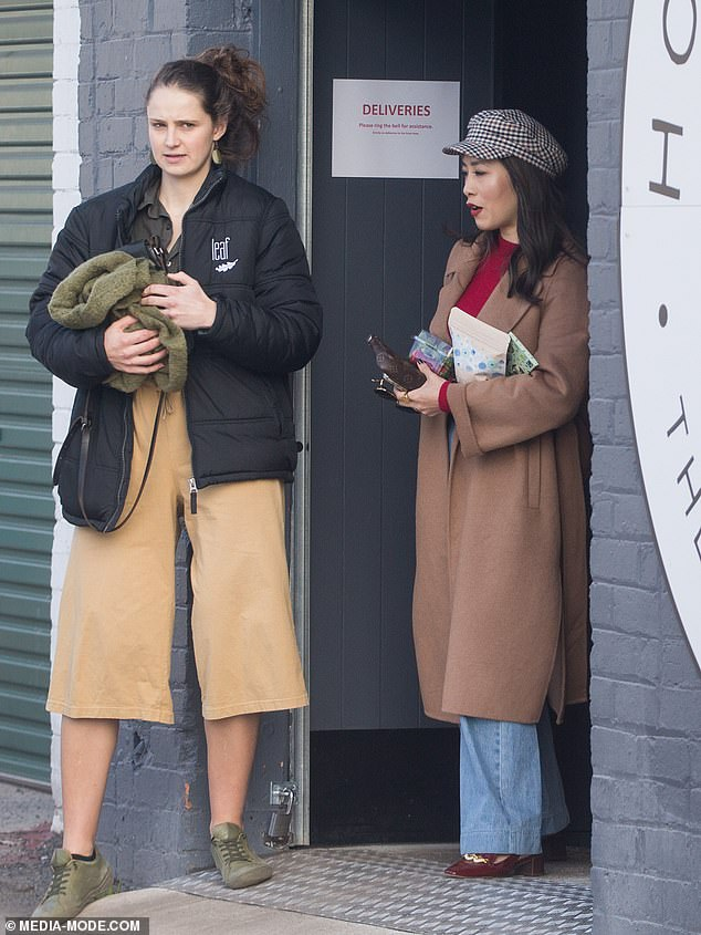 So chic!The food critic rugged up against the Melbourne chill in a trendy pair of flared jeans, flattering berry-coloured sweater and a long camel trench coat she worn open