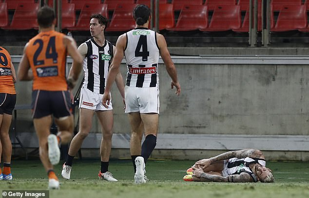 Sidebottom and Dunn's visit to Howe came a day after he seriously injured his knee (pictured) during Collingwood's clash with GWS on Friday night