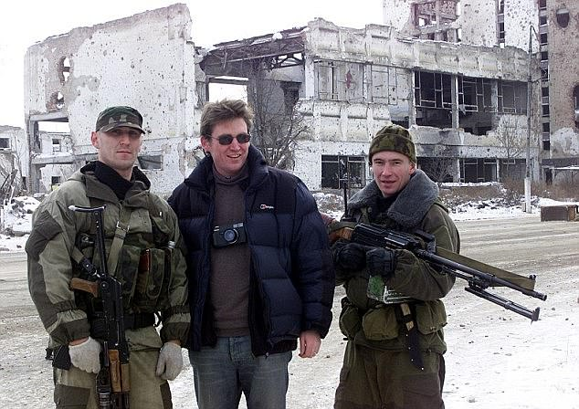 ulius, pictured during his days as a war correspondent with Russian soldiers in Chechnya, suffered from PTSD due to the harrowing scenes he witnessed