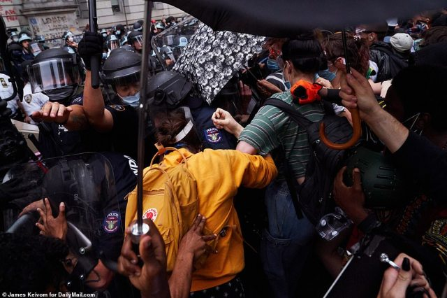 Some of the cops used batons to try to push crowds back. They responded by hitting the officers with their umbrellas