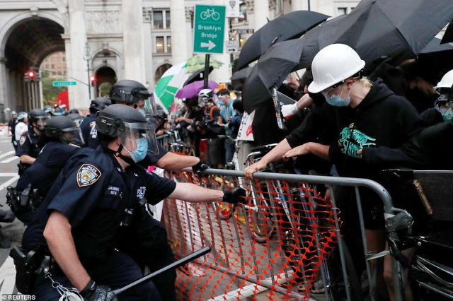 NYPD cops dismantle barricades surrounding the Occupy City Hall protest camp on Wednesday morning