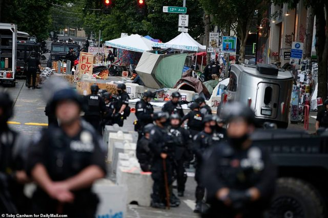 Calling the gathering at the East Precinct and Cal Anderson Park an 'unlawful assembly' Mayor Jenny Durkan had demanded all barriers be removed after a 525 per cent spike in violent crimes in the area