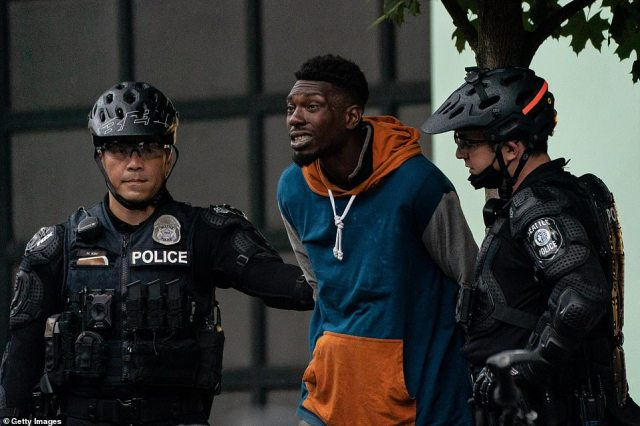 Police detain a person as city crews dismantle the Capitol Hill Organized Protest (CHOP) area. Thirty-one people were arrested this morning
