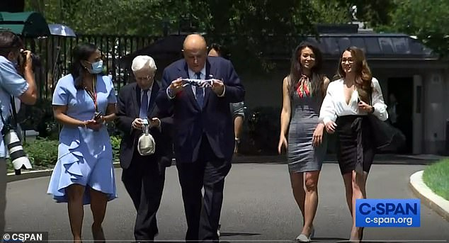 Rudy Giuliani popped up on the White House driveway on Wednesday where reporters asked him to stop and take questions