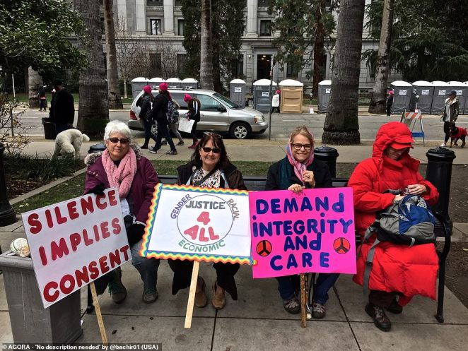 Pictured: A group of women out protesting hold placards with messages that include 'silence implies consent', 'Justice 4 all' and Demand integrity and care