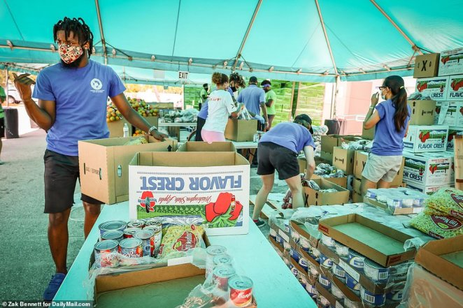 Employees are seen unpackaging canned goods and noodles on Wednesday