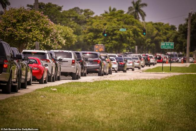 Cars were seen lined up bumper to bumper for two miles on Wednesday as they waited their turn for food