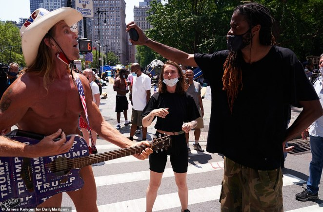 The Naked Cowboy was again met with anger from protesters - one day after he was turfed out the camp for the same behavior