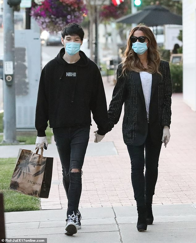 New: the couple was seen for the first time together while holding hands in April
