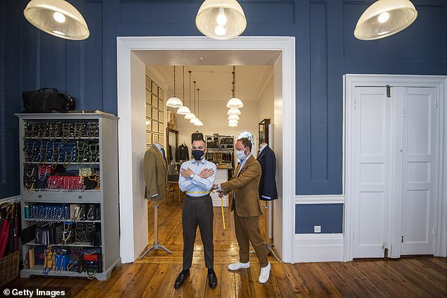 Tailors take around 27 measurements from their clients so they can craft them the perfect suit, with them now doing ti from the side rather than the front (pictured at Cad & Dandy)
