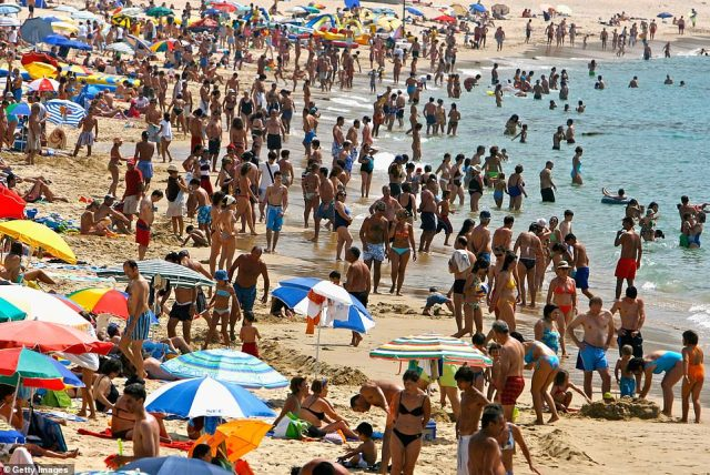 Portugal's foreign minister Agusto Santos Silva told Portuguese media: 'It it is absurd for a country like the United Kingdom which has seven times more cases than Portugal and 28 times more Covid-19 related deaths than we do to impose quarantine on the return of passengers from Portugal. Pictured: People enjoy the beach in Lagos, Portugal