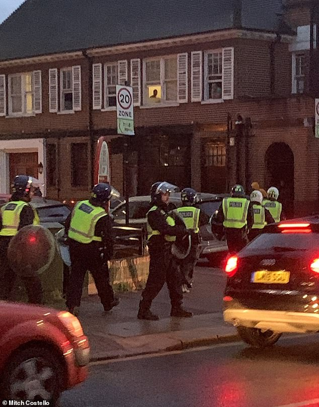 Police equipped with riot gear were deployed after bottles were thrown by revellers at the event in White City, west London