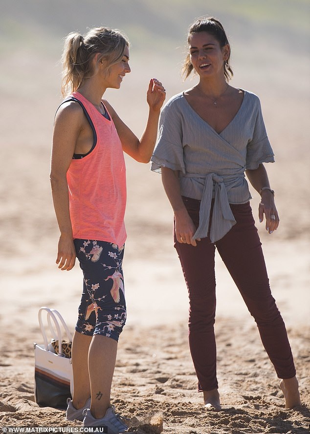 Working together: She also had a scene with co-star Emily Weir, who plays Mackenzie Booth,who dressed for their a grey low-neck wrap top with maroon skinny trousers