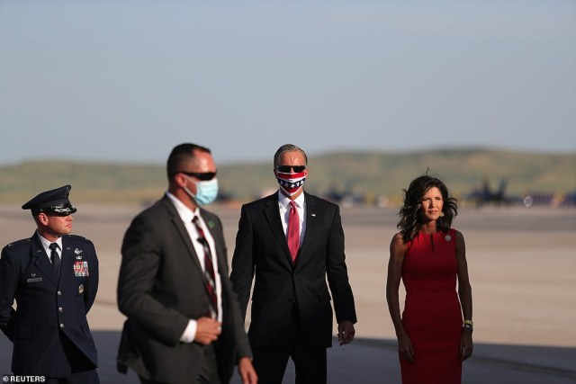 South Dakota Gov. Kristi Noem (right) greets the Trumps at Ellsworth Air Force Base, South Dakota Friday night