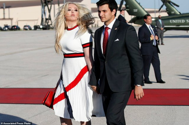 Tiffany Trump and her boyfriend Michael Boulos walk as they arrive with President Donald Trump on Air Force One upon arrival at Ellsworth Air Force Base, S.D., Friday, July 3, 2020. Trump is en route to Mount Rushmore National Memorial. (AP Photo/Alex Brandon)