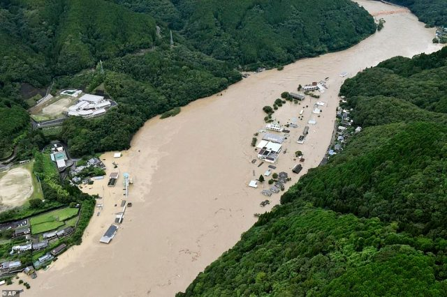 The nation's weather agency downgraded rain warnings by one notch from the highest emergency level in Kumamoto and Kagoshima on Kyushu island, but Prime Minister Shinzo Abe urged local people to be 'on maximum alert'