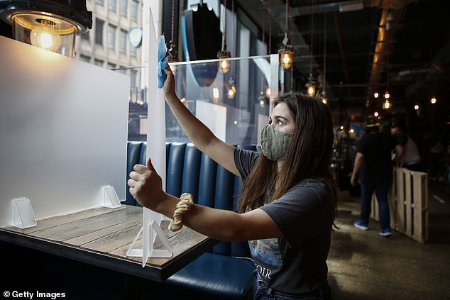 Staff at BrewDog Tower Hill tonight prepare to reopen tomorrow with social distancing measures in place