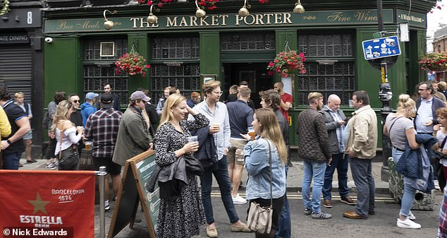 People enjoy Super Saturday at The Market Porter in Borough Market, central London, after it reopened under the easing of the lockdown
