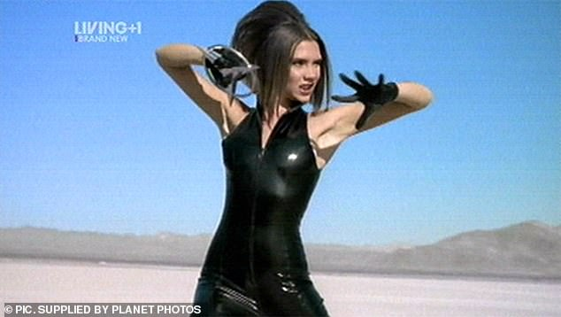 David revealed the moment he fell for his future wife two years before they got married, when he switched on the television to see Victoria singing 'Say You'll Be There' , whilst wearing a skintight black PVC outfit (pictured)