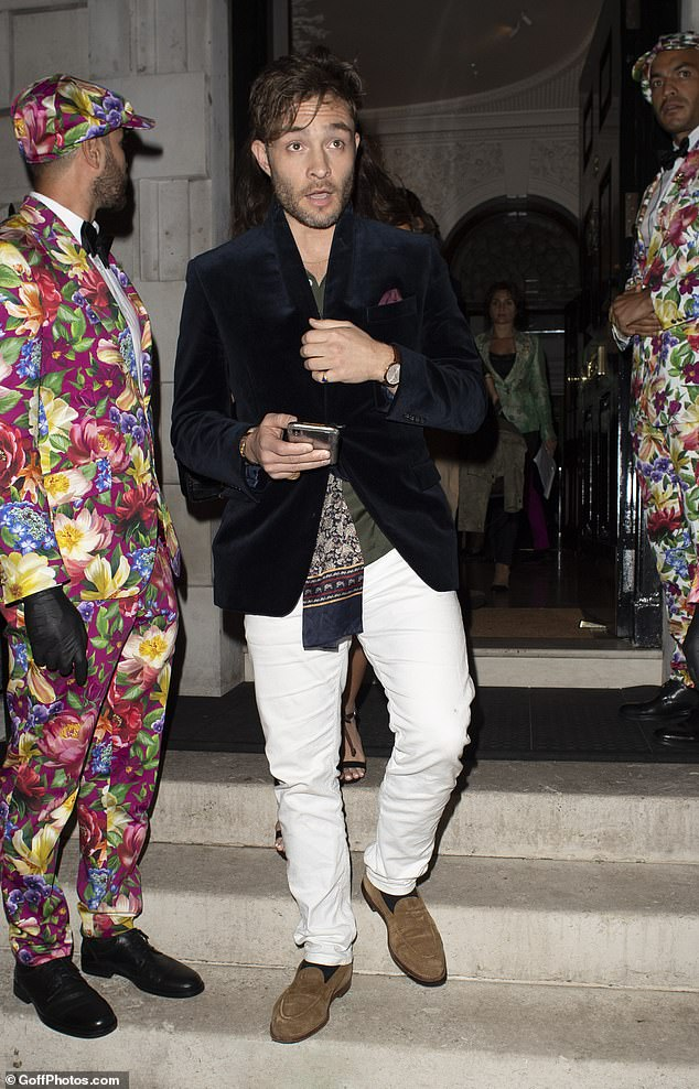 Something to celebrate?The White Gold star sported a printed Gucci scarf under a smart velvet blazer as he headed out of the famous celebrity hot spot