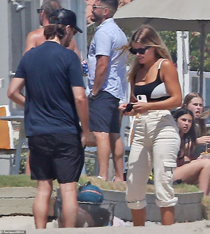 Breezy: Sofia's golden blonde hair was parted in the middle and flew in the breeze while she chatted with her beautiful