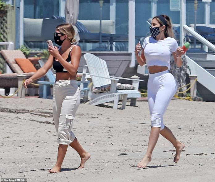 Girl time: Sofia and her partner walked along the shore together while taking a phone call