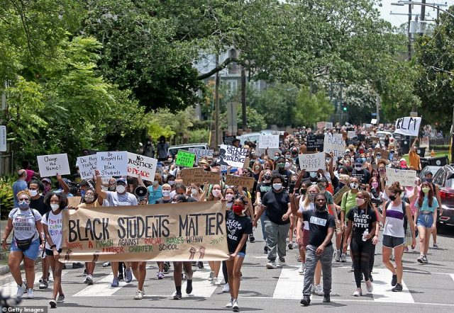People march to protest the name of the two educational institutions that comprise Lusher Charter School, marching from the elementary school campus on Willow Street to the high school campus of Freret Street in Louisiana