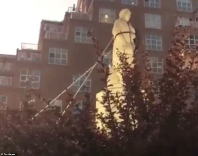 A group of demonstrators in Baltimore used ropes (pictured around the statue) to topple the Christopher Columbus monument and dump it into the city's Inner Harbor