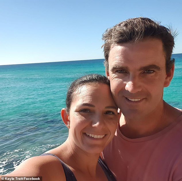 Matthew Tratt (pictured, right, with wife Kayla), 36, was attacked by a by a suspected great white shark at Fraser Island last week while spear fishing with his brother