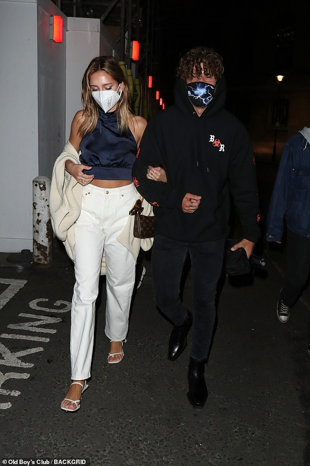 Out on the town: Delilah Hamlin and her boyfriend Eyal Booker stepped out in face masks in London on Saturday night