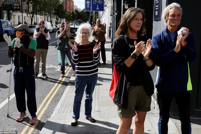 Members of the public applaud outside Chelsea and Westminster Hospital for the 72nd anniversary of the creation of the health service