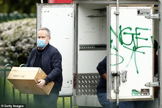 Former Labor leader and MP for Maribyrnong, Bill Shorten, delivers food to the Flemington Towers Government Housing on Monday