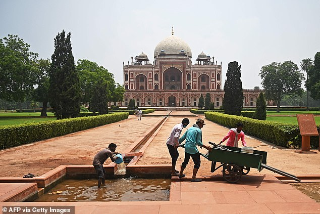 Workers clean an artificial water channel at the 16th-century Mughal monument, Humayun's Tomb, after it reopens for visitors, which has been closed since mid-March as part of measures to control the spread of the coronavirus COVID-19, in New Delhi in July.  6