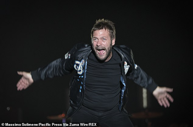 Controversy:Former Kasabian singer Tom Meighan will appear in court on Tuesday morning accused of assaulting his girlfriend, hours after stepping down from the band