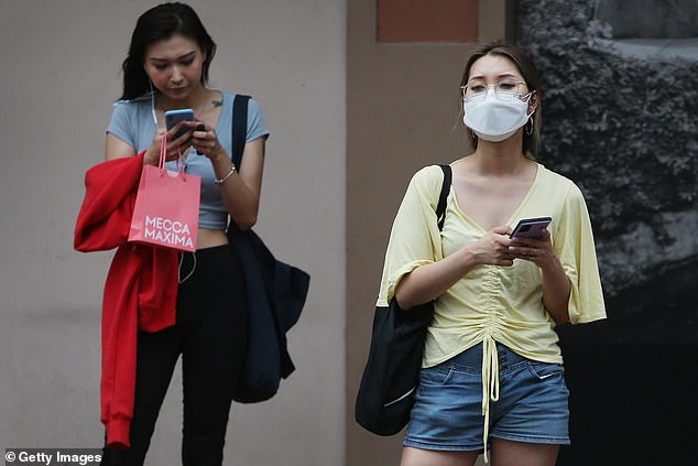 Plans for international students to return to Australia in the coming weeks have been out on hold as Victoria struggles to control a second wave of new infections. Pictured are women in Sydney's Chinatown