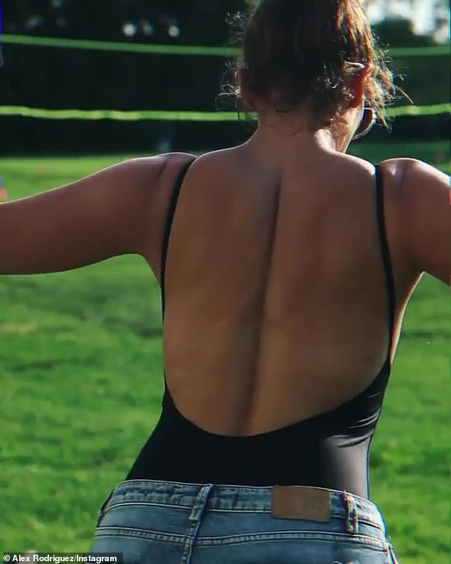 In shape: Jennifer shows off her killer physique with a closeup showing her back muscles as she lifts weights in a motion that causes them to ripple