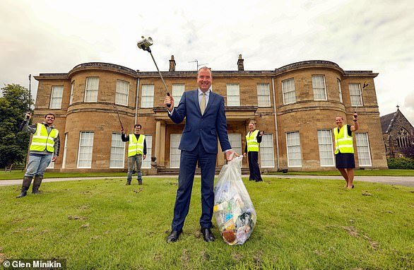 Litter picking heroes: Peter Banks, centre, with staff at Rudding Park hotel and spa