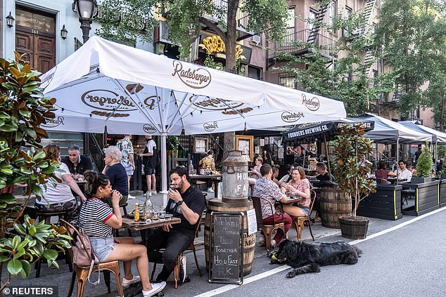 There are fears that July 4 celebrations will now drive a surge in new cases even in states that did beat their first wave, such as New York (pictured, bars open in the West Village)