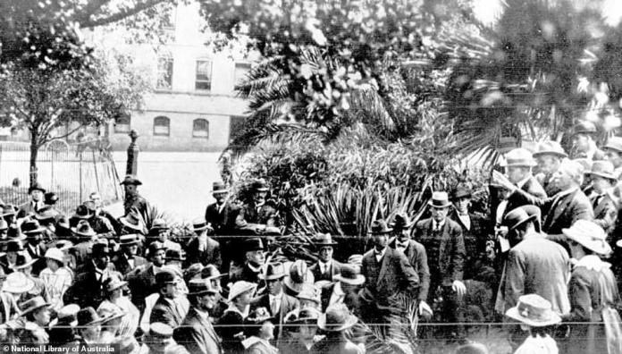 State border closures during the 1918 influenza pandemic created chaos along state lines, with many Australians left stranded, much like the 200 people pictured above at Melbourne's Treasury Gardens on February 4, 1919