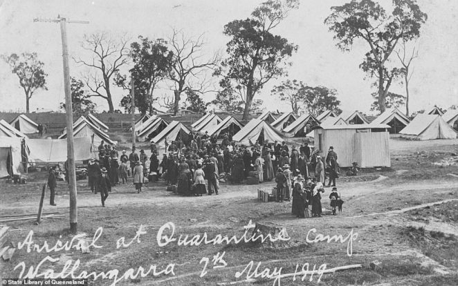 People are pictured arriving at the quarantine camp at Wallangarra in Queensland during the influenza epidemic of 1919
