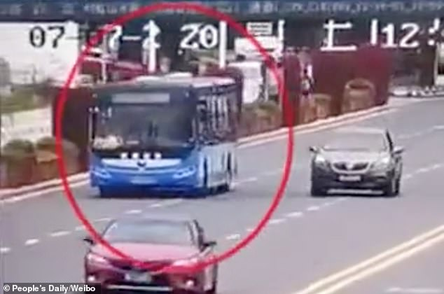Surveillance footage released by state media People's Daily shows the blue bus initially driving at a slow speed on the bridge before suddenly swerving into the ongoing traffic on Tuesday