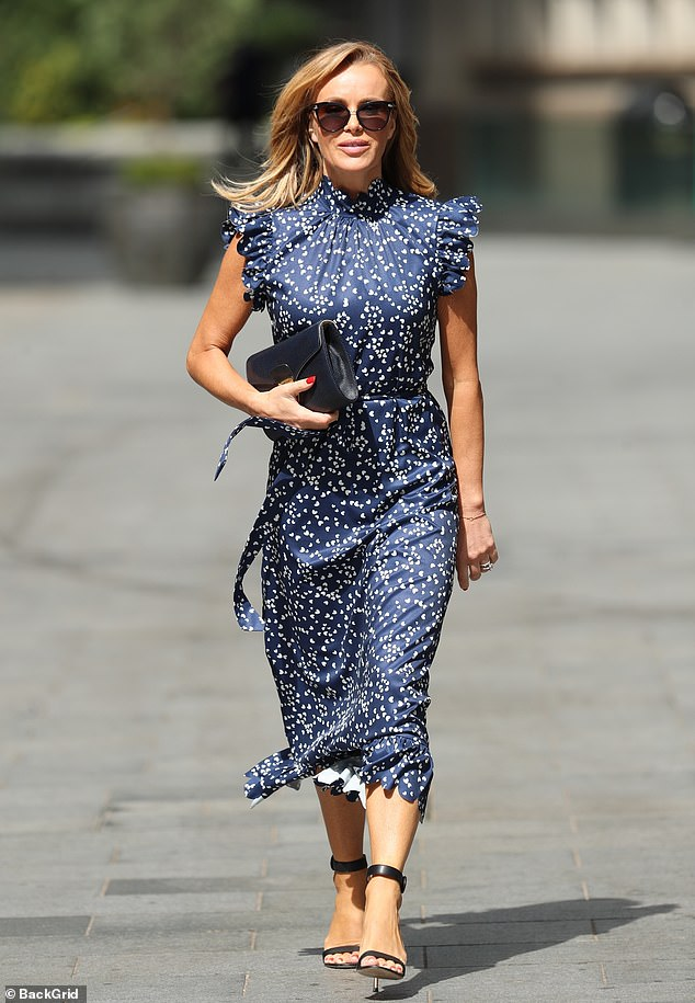 Style savvy:Amanda Holden commanded attention once again as she left work following another Heart Breakfast show in central London on Tuesday morning