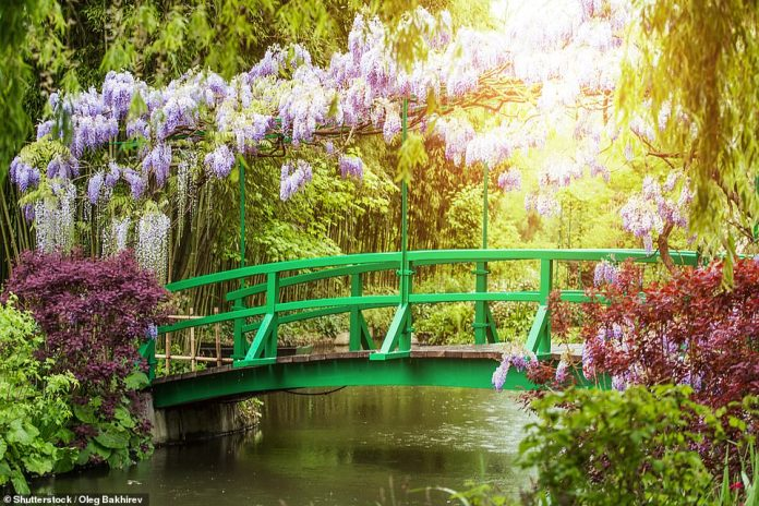 13 - Giverny in Normandy. Impressionist Claude Monet lived and worked here from 1883 until his death in 1926. This photo shows the village pond he owned and the bridge he painted several times