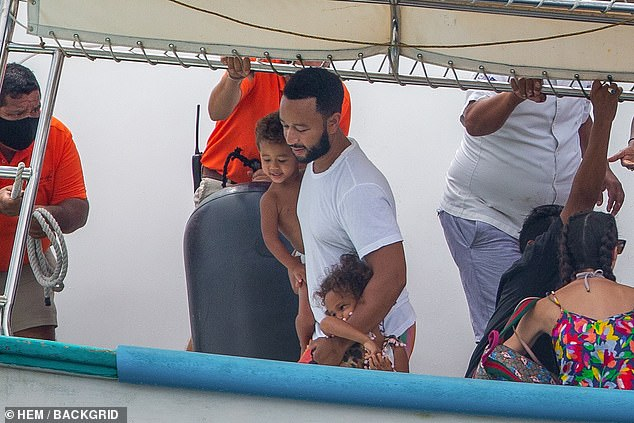 Good dad: Legend had his arms around his son Miles and his daughter Luna